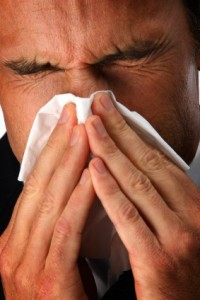 iStock_000008508312XSmall1.jpg-Man-with-a-cold-sneezing-into-a-tissue