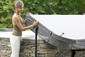 woman removing hot tub cover