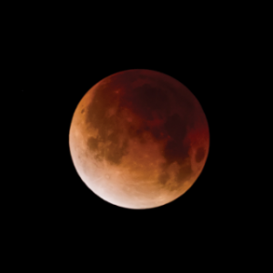 Lunar Eclipse turning the moon red for just a brief moment. Photo credit: ©mbarrettimages via Canva.com